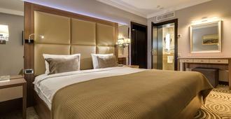 德涅斯特尊貴酒店 - 利沃夫 - 利沃夫 - 臥室