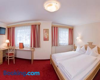 Hotel Edelweiss - Зерфаус - Bedroom