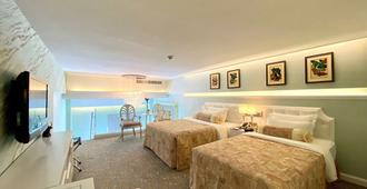 Metropole Hotel - Macau - חדר שינה