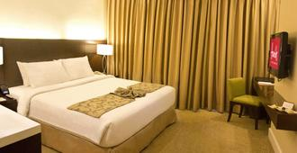 Harolds Hotel - Cebu City - Schlafzimmer