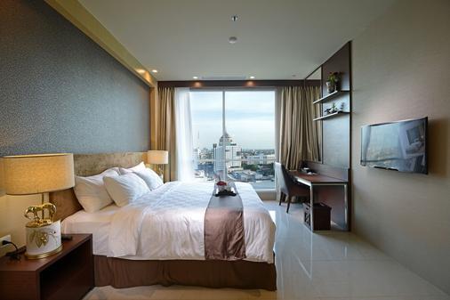 Aria Centra Hotel Surabaya - Surabaya - Phòng ngủ