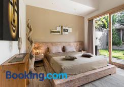 Exotica Bali Villa Bed and Breakfast - North Kuta - Bedroom