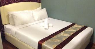 Woodpecker Lodge, Kuching - קוצ'ינג - חדר שינה