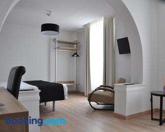 Grand Hôtel Brive - Brive-la-Gaillarde - Schlafzimmer