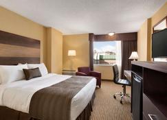 Days Inn by Wyndham Calgary South - Calgary - Slaapkamer