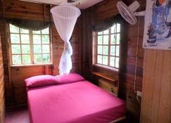 La Familia Guest House and Natural Farm - Long Bay - Bedroom
