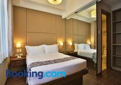 Valero Grand Suites By Swiss-Belhotel Makati - Μακάτι - Κρεβατοκάμαρα