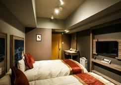 Hotel Relief Namba Daikokuchou - Osaka - Bedroom