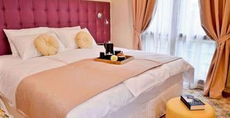 Capitolina City Chic Hotel - קלוז'-נאפוקה - חדר שינה