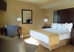 Cocca's Inn & Suites Wolf Rd, Albany Airport - Albany - Bedroom