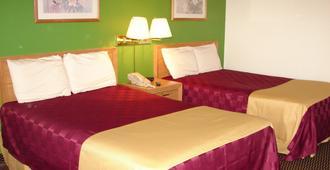 Columbus Inn & Suites - Columbus - Makuuhuone