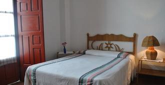 Hotel Posada San Agustin - פצקוארו - חדר שינה