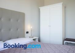 德格里奧莱安德里酒店 - 西米歐涅 - 西爾米奧奈 - 臥室