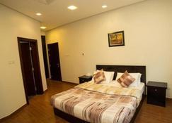 Golden Rose Luxury Suites - Manama - Habitación