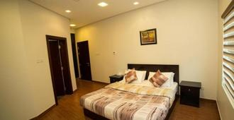 Golden Rose Luxury Suites - Μανάμα - Κρεβατοκάμαρα