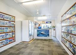 Bush Village Holiday Cabins - Airlie Beach - Tienda