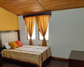 Sarah's Boutique Hotel y Restaurante - Coban - Bedroom