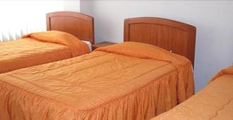 Hostal Business Inn & Mystic Suite - פונו - חדר שינה