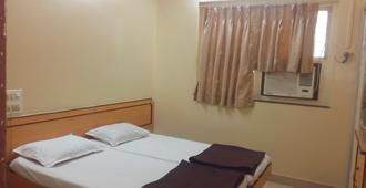 Milan Guest House - Mumbai - Bedroom