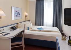carathotel München City - Munich - Bedroom
