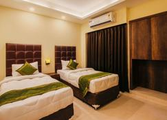 Treebo Hotel Mount View - Siliguri - Bedroom