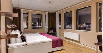 هوتل فيريسلوند - أبسالا - غرفة نوم