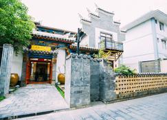 Floral Hotel Qiannan Mulanfang - Yuping - Здание