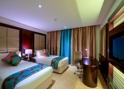 Holiday Inn Muscat Al Seeb - Маскат - Спальня