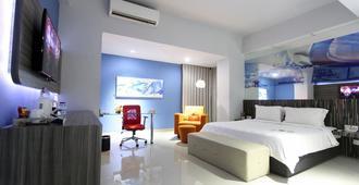G Suites Hotel By Amithya - סוראבאיה - חדר שינה