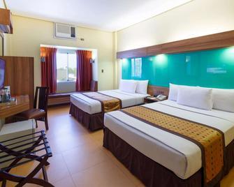 Microtel by Wyndham Davao - Davao City - Bedroom