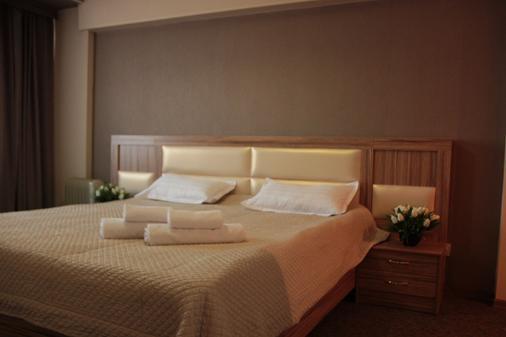 Hotel Dostuk - Bishkek - Phòng ngủ