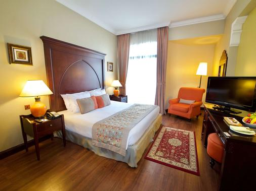 Mercure Grand Hotel Seef - All Suites - Manama - Camera da letto