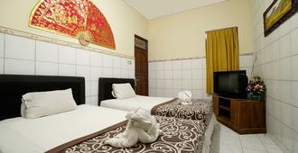Gong Corner Guesthouse 2 - Hostel - Kuta - Bedroom