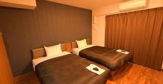 Hotel Trad Osaka Tsuruhashi - אוסקה - חדר שינה