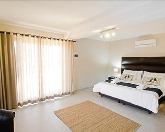 Cavallo Guesthouse - Віндгук - Bedroom