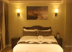 Clark Imperial Hotel - Angeles City - Schlafzimmer