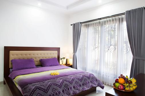 A'guest House - Denpasar - Bedroom