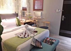 Red Mango Suites - Pasig - Habitación