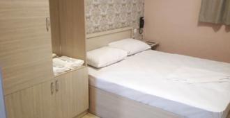 Green Garden Hotel - ירבאן - חדר שינה