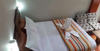 Hostal Vista Waynapata - Machu Picchu - חדר שינה