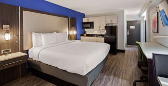 Best Western Plus Executive Residency Denver-Central Park Hotel - Denver - Bedroom