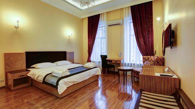 Sleepy Tom Hotel - Moskova - Makuuhuone