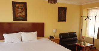 クルミ ホステル - クスコ - 寝室