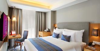 Swiss-belhotel Pondok Indah - ג'קרטה - חדר שינה