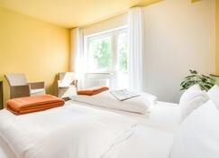 โรงแรมบิโชฟส์ลินเดอ - ไฟรบูรก์ อิม ไบรส์เกา - ห้องนอน
