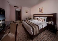 Golden Tulip Bahrain - Manama - Soveværelse