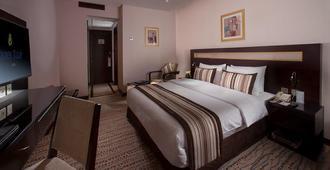Golden Tulip Bahrain - Manama - Phòng ngủ