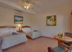 SunBreeze Hotel - San Pedro Town - Schlafzimmer