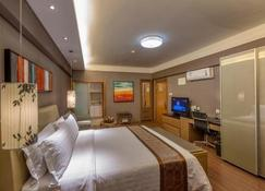 Peninsula Season Hotel Apartment - Qinhuangdao - Habitación