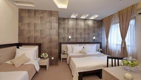 Hotel Vozarev - Белград - Спальня